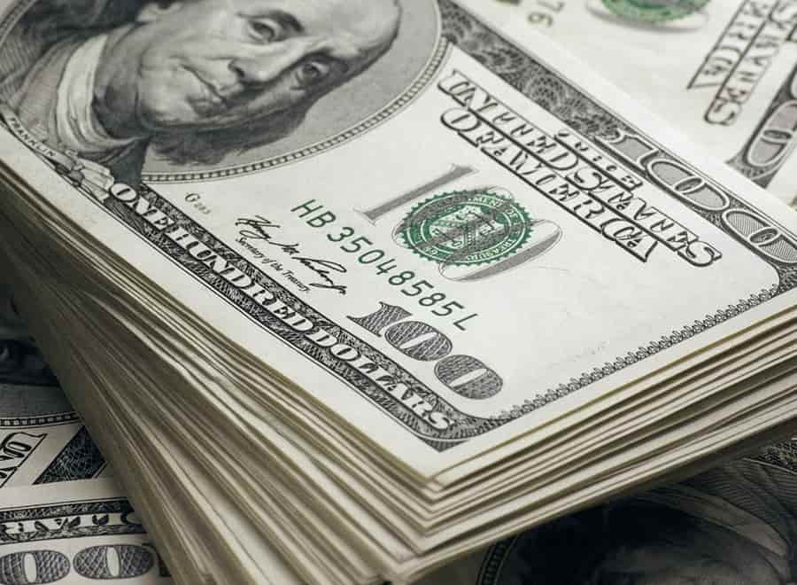 Dollar edges higher as data helps lift Treasury yields